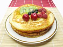 Sweet pancakes with fruits Stock Images