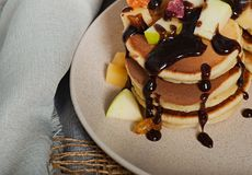 Sweet pancakes with fruits, candied fruits and cheese, homemade Royalty Free Stock Images