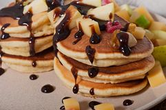 Sweet pancakes with fruits, candied fruits and cheese, homemade Royalty Free Stock Photo