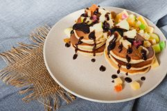 Sweet pancakes with fruits, candied fruits and cheese, homemade Royalty Free Stock Photos