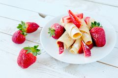 Sweet pancakes with fruits Stock Photos