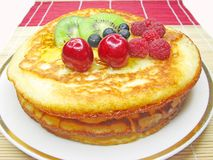 Sweet pancakes with fruits in syrup Royalty Free Stock Photo