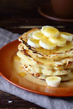 Sweet pancakes with honey and bananas on a plate Stock Photos