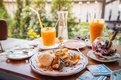 Sweet Pancakes with honey and vanilla ice cream Fruit with Orang Royalty Free Stock Photography