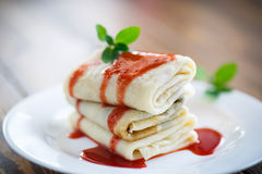 Sweet pancakes with strawberry jam Stock Photography