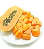 Sweet papaya in dish on white background Royalty Free Stock Images