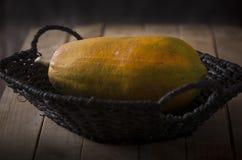 Sweet Papaya. Fresh Sweet Papaya over rustic wooden table Royalty Free Stock Photo
