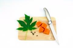 Sweet papaya slice on chopping bord Stock Image