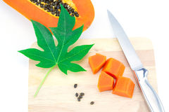 Sweet papaya slice on chopping bord Royalty Free Stock Photos