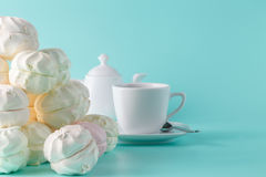 Sweet pastel colored marshmallow and cup of coffee on aquamarine Stock Photo