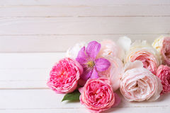 Sweet pastel roses and clematis flower on white  wooden backgrou Royalty Free Stock Photo