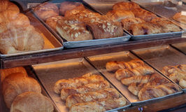 Sweet pastries in bakery window Royalty Free Stock Photos