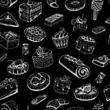 Sweet pastries on chalkboard Royalty Free Stock Photography