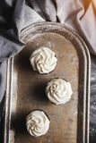 Sweet pastries, muffins and cupcakes on the table royalty free stock photography