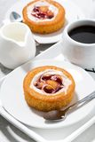 Sweet pastry with cream, jam and a cup of coffee, vertical Royalty Free Stock Image