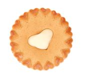 Sweet pastry with white cream heart. Royalty Free Stock Photography