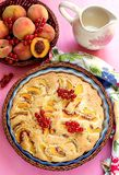 Sweet peach cake with red currants Royalty Free Stock Photos