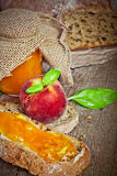 Sweet peach jam on bread Royalty Free Stock Photo