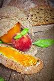 Sweet peach jam on bread Royalty Free Stock Photography