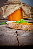 Sweet peach jam on bread Royalty Free Stock Image