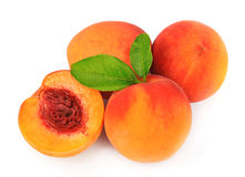 Sweet peaches with leafs. On a white background Royalty Free Stock Photography