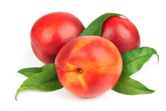 Sweet peaches with leafs. On a white background Stock Image