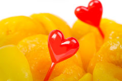 Sweet peaches and red heart shapes Royalty Free Stock Photography