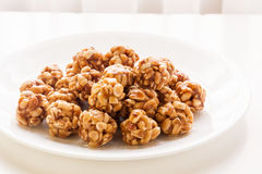 Sweet peanut balls in a plate. On a table with natural light from window Stock Photography
