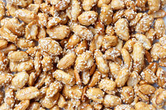Sweet peanuts with sesame. Sweet peanuts with sugar and sesame closeup,this is Chinas traditional snack Royalty Free Stock Images