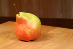 Sweet pear. Fresh juicy colorful pear on wooden background Royalty Free Stock Image