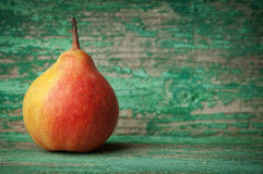 Sweet pear closeup on wooden background Stock Photography