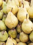 Sweet pears in big market Royalty Free Stock Image