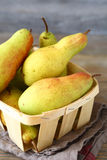 Sweet pears in a wooden box Royalty Free Stock Photo