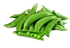 Sweet peas. Fresh sweet peas on white stock images