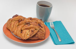 Sweet pecan bun and a cup of black coffee Royalty Free Stock Photo