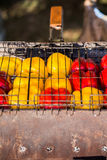 Sweet pepper on  barbecue grid. Fresh yellow and red peppers on the grill for a barbecue royalty free stock images