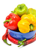 Sweet pepper, chili pepper in the plate. Isolated on white Royalty Free Stock Photo