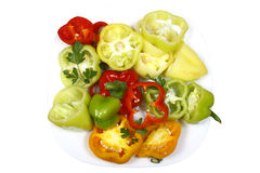 Sweet pepper chopped multicolored on a plate Royalty Free Stock Image