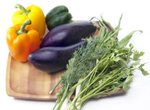Sweet pepper, eggplant, parsley and fennel on a wooden tray Royalty Free Stock Photo