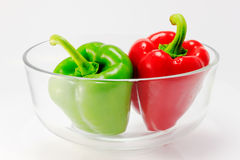 Sweet pepper in glass bowl. Red and green sweet pepper in glass bowl Royalty Free Stock Photography