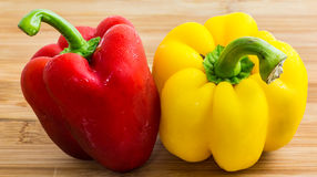 Sweet pepper. Red and yellow sweet pepper on wooden cutting board Stock Image