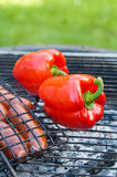 Sweet pepper and sausages on a grill Royalty Free Stock Photo