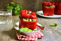 Sweet pepper stuffed with rice and basil pesto. Stock Image