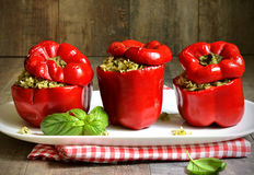 Sweet pepper stuffed with rice and basil pesto. Stock Photos