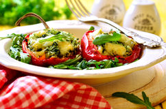 Sweet pepper stuffed with rice,spinach and cheese. Royalty Free Stock Images
