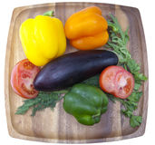 Sweet pepper, tomato, eggplant, parsley and fennel on a wooden tray Royalty Free Stock Photo