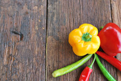 Sweet pepper yellow green red on wood table Stock Image