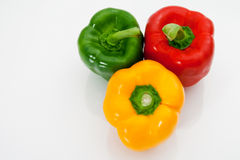 Sweet peppers. Red, yellow and green sweet peppers macro on a white background Stock Photo