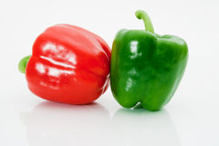 Sweet peppers. Red and green sweet peppers macro on a white background Royalty Free Stock Photography