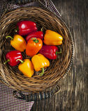 Sweet peppers in the basket. Stock Photos